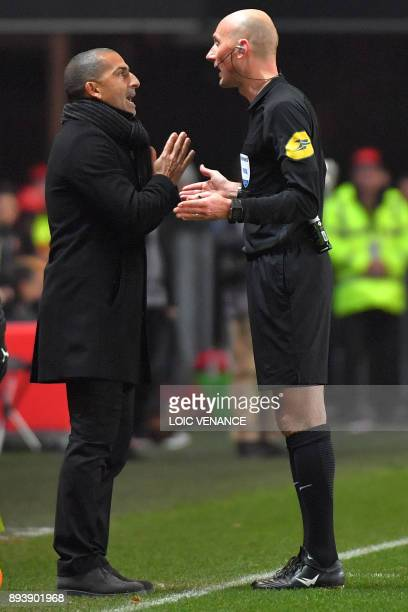Rennes' French coach Sabri Lamouchi argues with the referee during the French L1 football match between Rennes and Paris Saint Germain on December 16...