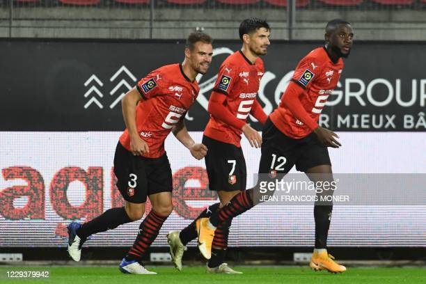 Rennes' French defender Damien Da Silva celebrates with team mates after scoring a goal during the French L1 football match between Rennes and Brest...