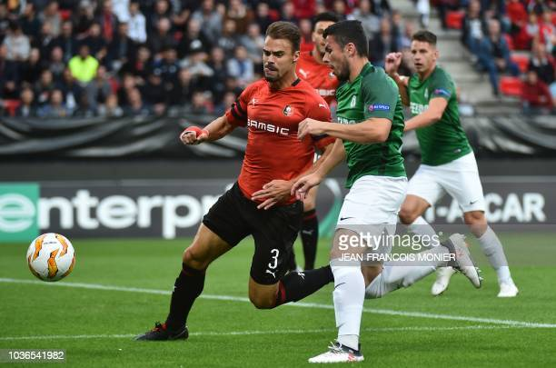 Rennes' French forward Hatem Ben Arfa celebrates with teammates after scoring a penalty during the Europa League C3 Group K football match between...