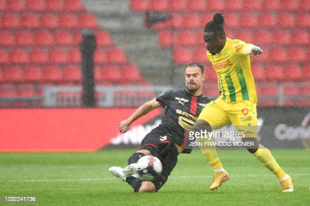 Rennes' French defender Damien Da Silva fights for the ball with Nantes' Nigerian forward Moses Simon during the French L1 football match between...