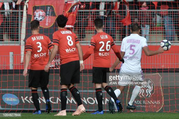 Rennes' French defender Damien Da Silva Rennes's French midfielder Clement Grenier and Rennes' French defender Jeremy Gellin looks the ball getting...