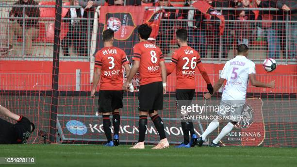 Rennes' French defender Damien Da Silva Rennes's French midfielder Clement Grenier and Rennes' French defender Jeremy Gellin look at the ball getting...