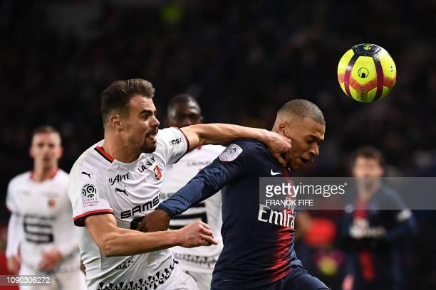 Rennes' French defender Damien Da Silva vies for the ball with Paris SaintGermain's French forward Kylian Mbappe during the French L1 football match...