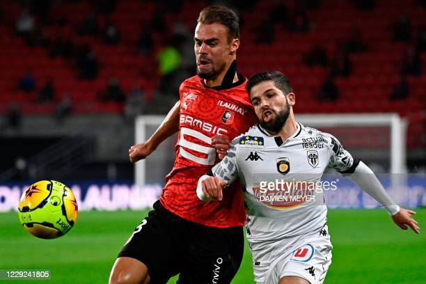 Rennes' French defender Damien Da Silva vies with Angers' French midfielder Jimmy Cabot during the French L1 football match between Stade Rennais and...