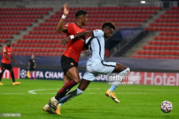 Rennes' French defender Gerzino Nyamsi fights for the ball with Chelsea's English forward Tammy Abraham during the UEFA Champions League Group E...