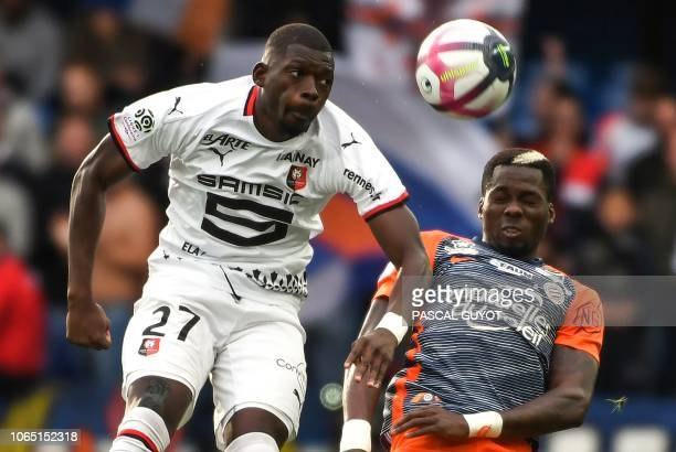 Rennes' French defender Hamari Traore fights for the ball with Montpellier's Cameroon midfielder Ambroise Oyongo during the French L1 football match...