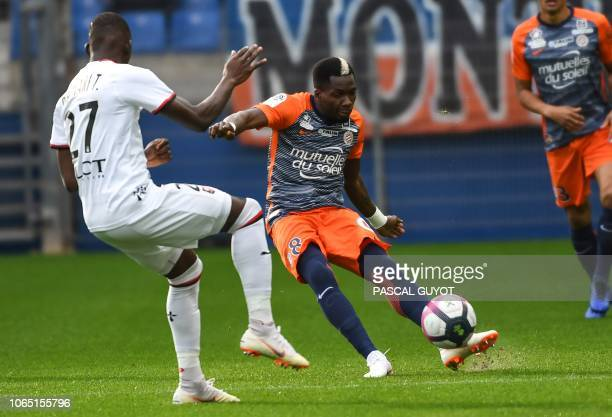 Rennes' French defender Hamari Traore vies with Montpellier's Cameroon midfielder Ambroise Oyongo during the French Ligue 1 football match between...