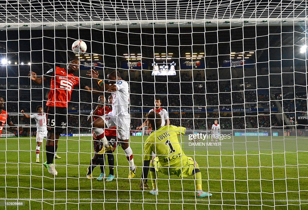 Rennes' French defender Jean Makoun (L) heads the ball and saves a goal beside Lille's Cameroonian midfielder Aurelien Chedjou (2ndL) during the French L1 football match Stade Rennais FC vs Lille LOSC, on September 28, 2012, at the route de Lorient stadium in Rennes, western France.