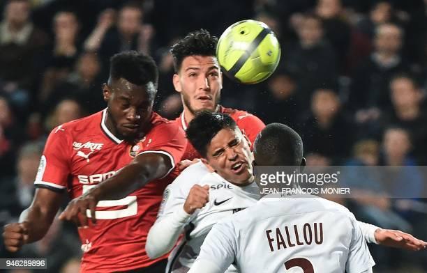 Rennes' French defender Joris Gnagnon and Rennes' Algerian defender Ramy Bensebaini vie with Metz's Argentinian midfielder Geronimo Poblete and...