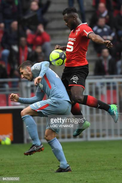 Rennes' French defender Joris Gnagnon vies with Monaco's Yugoslavian forward Stevan Jovetic during the French L1 football match Rennes vs Monaco at...