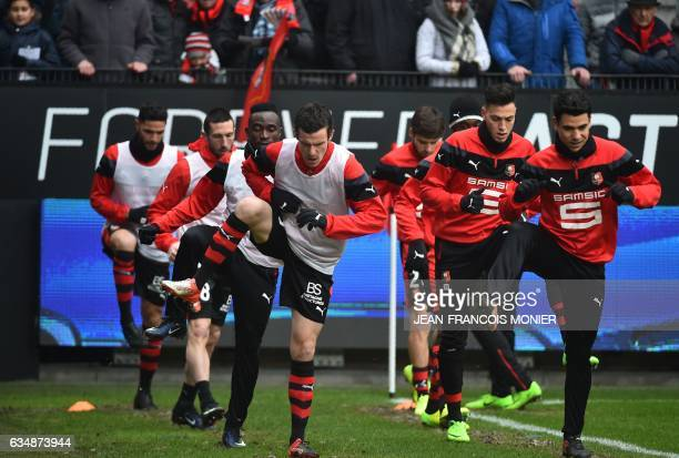 Rennes' French defender Romain Danze Rennes' Algerian defender Ramy Bensebaini and Rennes' French midfielder Benjamin Andre warm up before the French...