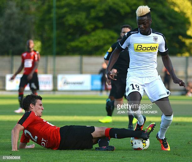 Rennes' French defender Romain Danze vies for the ball with Angers' French forward Nicolas Pepe during the French L1 friendly football match between...