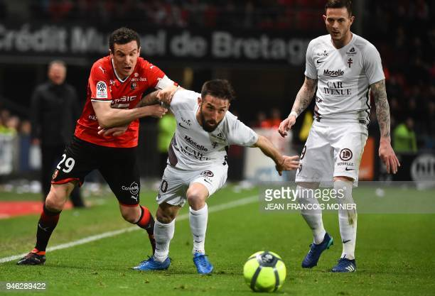 Rennes' French defender Romain Danze vies with Metz's French defender Julian Palmieri during the French L1 football match between Rennes and Metz on...