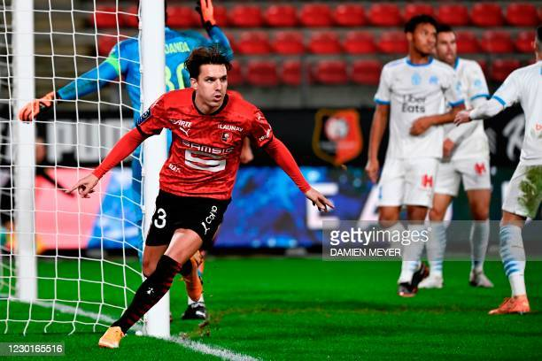 Rennes' French forward Adrien Hunou celebrates after scoring a goal during the French L1 football match between Rennes and Marseille , at the Roazhon...