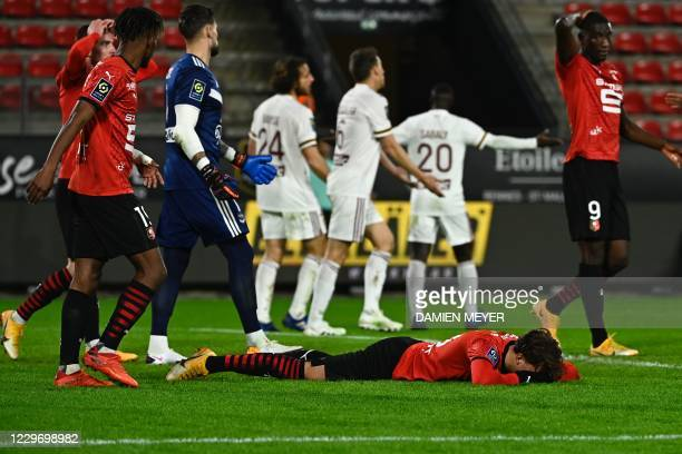 Rennes' French forward Adrien Hunou reacts on the ground after missing a goal during the French L1 football match between Stade Rennais and Bordeaux,...