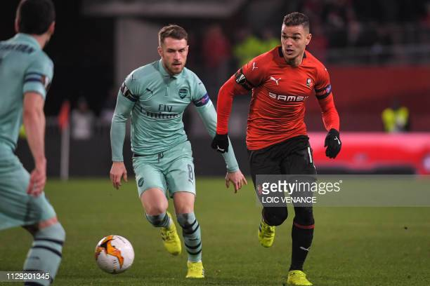 Rennes' French forward Hatem Ben Arfa fights for the ball with Arsenal's Welsh midfielder Aaron Ramsey during UEFA Europa League round of 16 first...