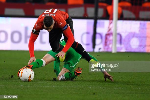 Rennes' French forward Hatem Ben Arfa is tackled by Real Betis' Spanish midfielder Giovanni Lo Celso during the UEFA Europa League round of 32...