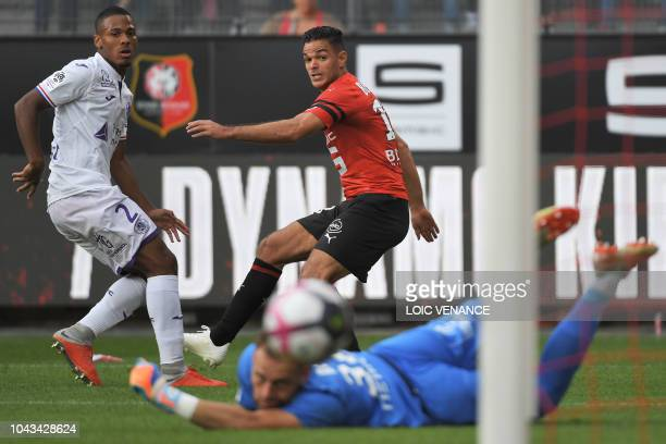 Rennes' French forward Hatem Ben Arfa tries to score past Toulouse's French goalkeeper Baptiste Reynet during the French L1 football match Rennes vs...