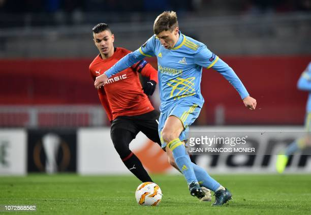 Rennes' French forward Hatem Ben Arfa vies for the ball with Astana's Croatian midfielder Marin Tomasov during the UEFA Europa League Group K...