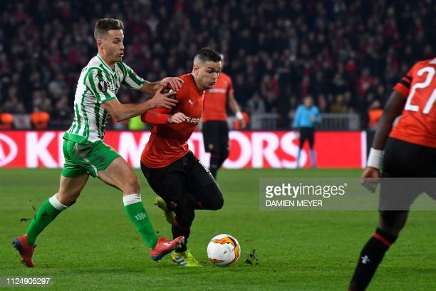 Rennes' French forward Hatem Ben Arfa vies for the ball with Real Betis' Spanish defender Sergio Canales during the UEFA Europa League round of 32...