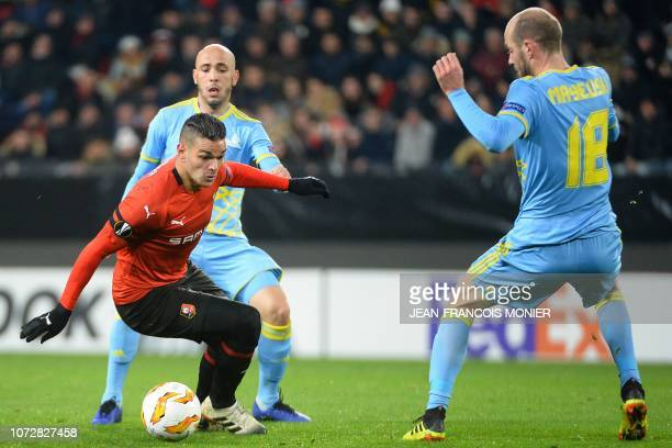Rennes' French forward Hatem Ben Arfa vies with Astana's Azerbaijani midfielder Richard Almeida de Oliveira and Astana's Belarus midfielder Ivan...