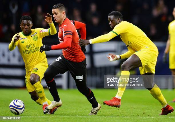 Rennes' French forward Hatem Ben Arfa vies with Nantes' Ghanaian forward Abdul Majeed Waris and Nantes' French defender Batista Mendy during the...
