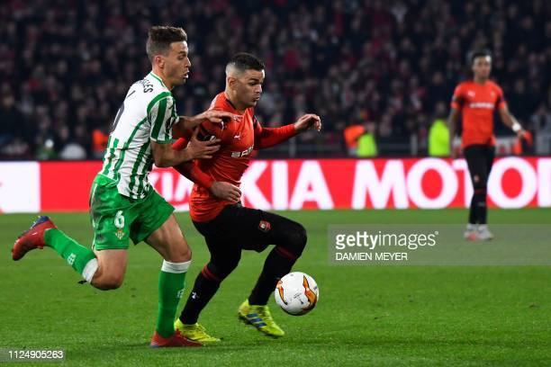 Rennes' French forward Hatem Ben Arfa vies with Real Betis' Spanish defender Sergio Canales during the UEFA Europa League round of 32 firstleg...