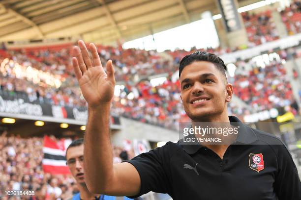 Rennes' French forward Hatem Ben Arfa waves as he is presented to supporters prior to the French L1 football match between Rennes and Bordeaux, on...