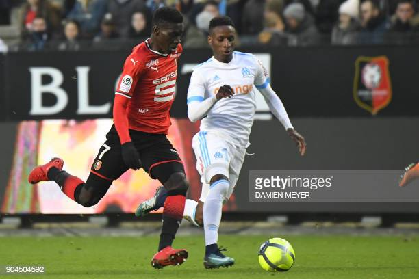 Rennes' French forward Ismaila Sarr vies with Olympique de Marseille's French forward Bouna Sarr during the French L1 football match Rennes vs...