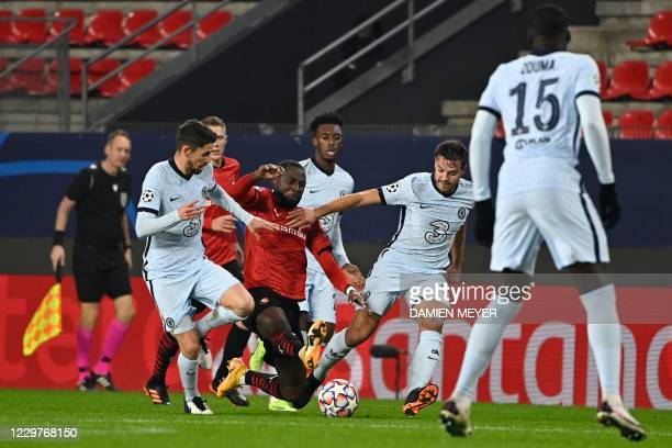 Rennes' French forward James Lea Siliki fights for the ball with Chelsea's Spanish defender Cesar Azpilicueta during the UEFA Champions League Group...