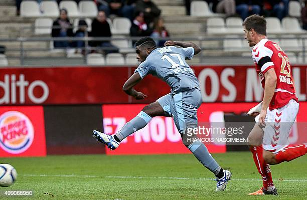 Rennes' French forward Jeremie Boga shoots and scores during the French L1 football match between Reims and Rennes at the Auguste Delaune Stadium in...