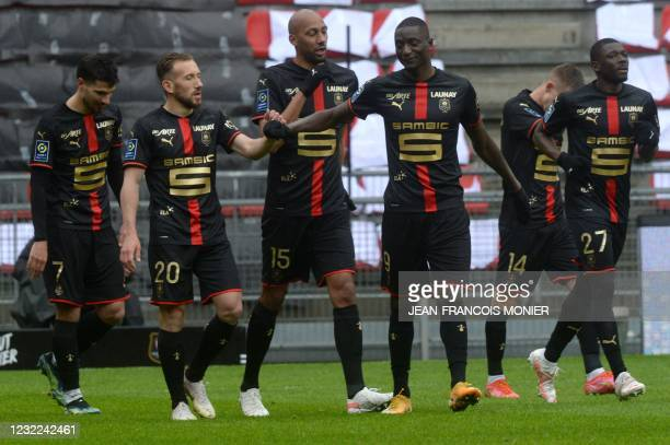 Rennes' French forward Martin Terrier and his teammates react after scoring during the French L1 football match between Stade Rennais and FC Nantes...