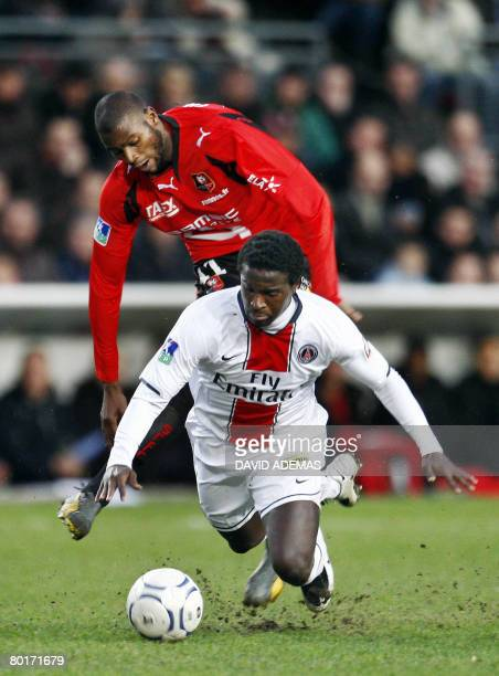 Rennes' French forward Olivier Thomert vies with Paris' French defender Bernard Mendy during their French L1 football match on March8 2008 at the...