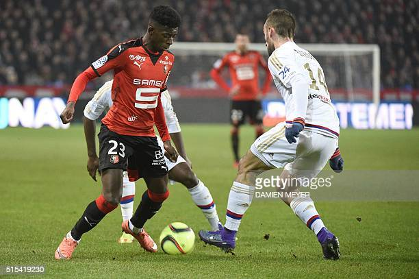 Rennes' French forward Ousmane Dembele vies with Lyon's Spanish midfielder Sergi Darder during the French L1 football match Rennes against Lyon on...