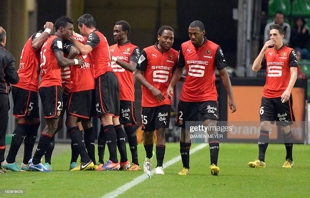 Rennes' French forward Romain Alessandrini (L) celebrates with teammates after scoring during the French L1 football match Stade Rennais FC vs Lille LOSC, on September 28, 2012, at the route de Lorient stadium in Rennes, western France.