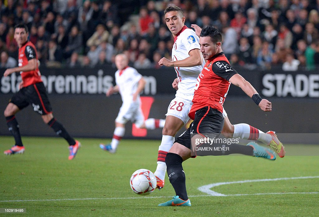 Rennes' French forward Romain Alessandrini (R) kicks the ball beside Lille's Argentinian defender Mauro Cetto during the French L1 football match Stade Rennais FC vs Lille LOSC, on September 28, 2012, at the route de Lorient stadium in Rennes, western France.