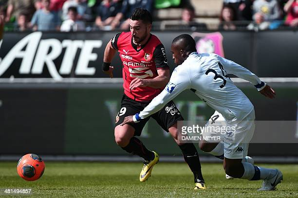 Rennes' French forward Romain Alessandrini vies for the ball with Bastia's Malian midfielder Abdoulaye Keita during the French L1 football match...