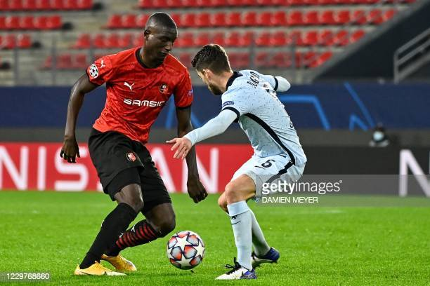 Rennes' French forward Sehrou Guirassy fights for the ball with Chelsea's Italian midfielder Jorginho during the UEFA Champions League Group E...