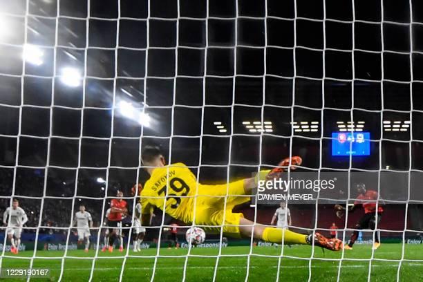 Rennes' French forward Sehrou Guirassy scores a penalty against FK Krasnodar's Russian goalkeeper Matvey Safonov during the UEFA Europa League Group...