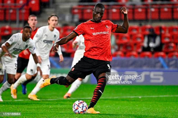 Rennes' French forward Sehrou Guirassy scores a penalty during the UEFA Europa League Group E first-leg football match between Stade Rennais FC and...