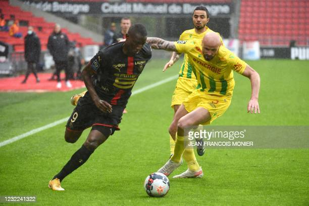 Rennes' French forward Serhou Guirassy vies with Nantes' French defender Nicolas Pallois during the French L1 football match between Stade Rennais...