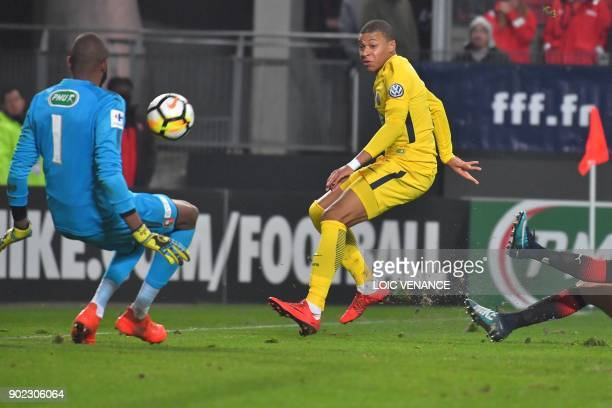 Rennes' French goalkeeper Abdoulaye Diallo fights for the ball with Paris SaintGermain's French forward Kylian Mbappe during the French Cup football...