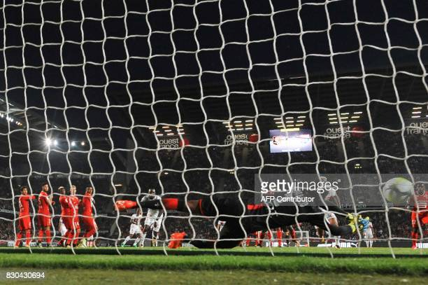 Rennes' French goalkeeper Abdoulaye Diallo reaches for the ball during the French L1 football match between Stade Rennais and Olympique Lyonnais on...