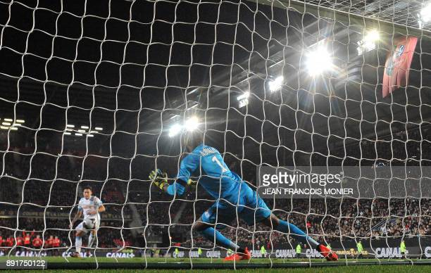 Rennes' French goalkeeper Abdoulaye Diallo saves the penalty of Olympique de Marseille's Argentinian forward Lucas Ocampos and qualifies his team...