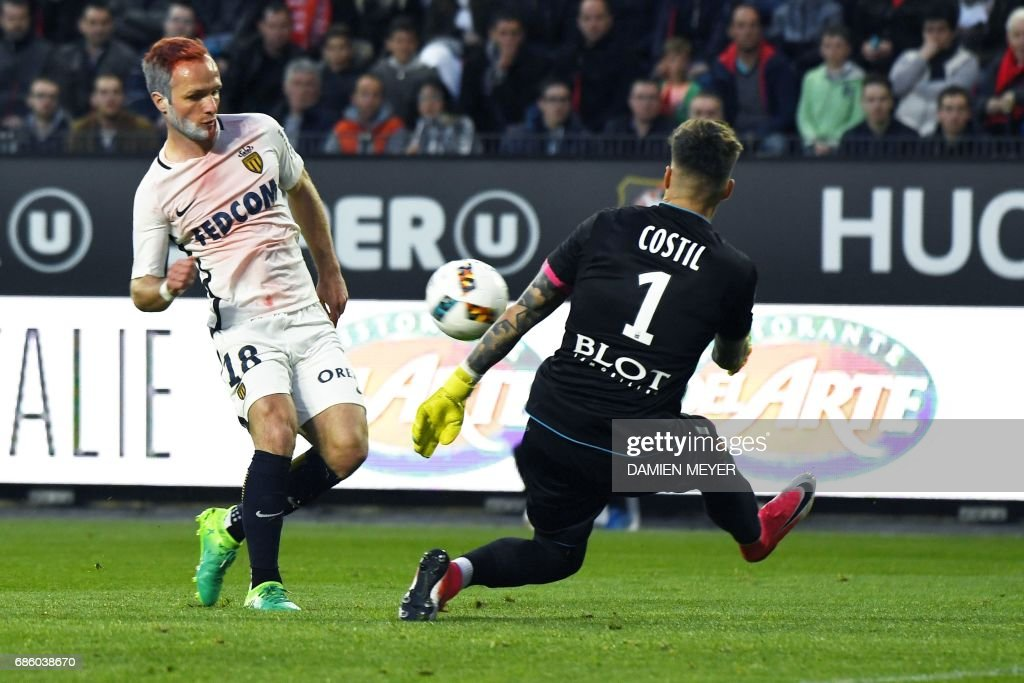 Rennes' French goalkeeper Benoit Costil (R) saves a goal from Monaco's French forward Valere Germain during the French L1 football match between Lyon (OL) and Nice (OGCN) on May 20, 2017, at the Parc Olympique Lyonnais stadium in Decines-Charpieu near Lyon, central-eastern France. /