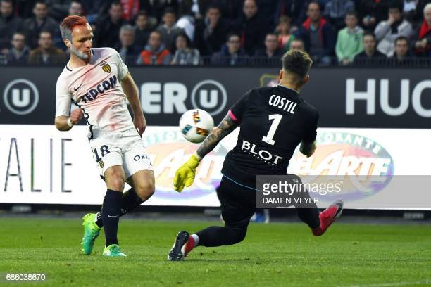 Rennes' French goalkeeper Benoit Costil saves a goal from Monaco's French forward Valere Germain during the French L1 football match between Lyon and...