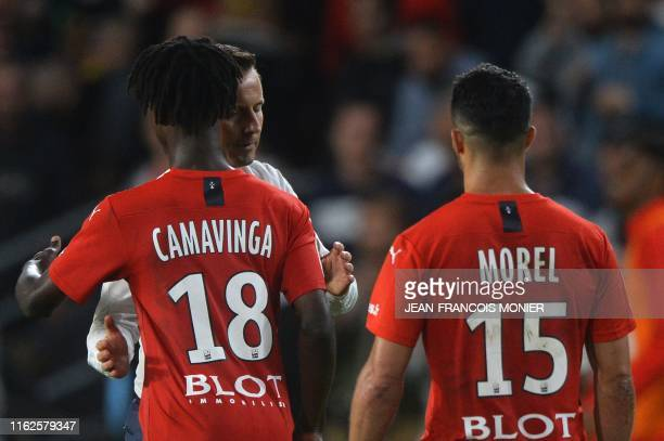 Rennes' French head coach Julien Stephan hugs Rennes' French midfielder Eduardo Camavinga after the French L1 Football match between Rennes and Paris...