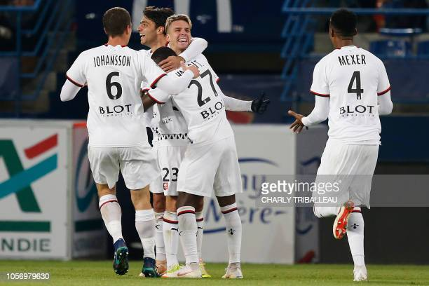 Rennes' French midfielder Adrien Hunou celebrates after scoring during the French L1 football match between Stade Malherbe Caen and Stade Rennais...