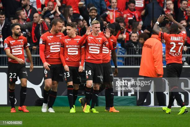 Rennes' French midfielder Adrien Hunou celebrates with teammates after scoring a goal during the French L1 football match between Stade Rennais and...