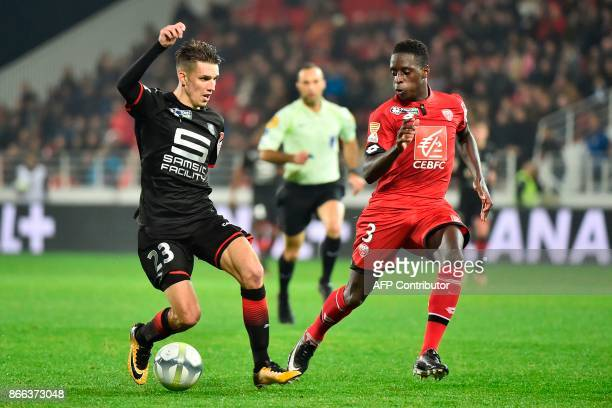 Rennes' French midfielder Adrien Hunou vies with Dijon's French midfielder Anthony Belmonte during the French League Cup round of 16 football match...